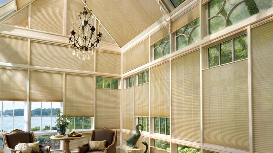 sunroom with Duette Architella Honeycomb Shades by Decorview