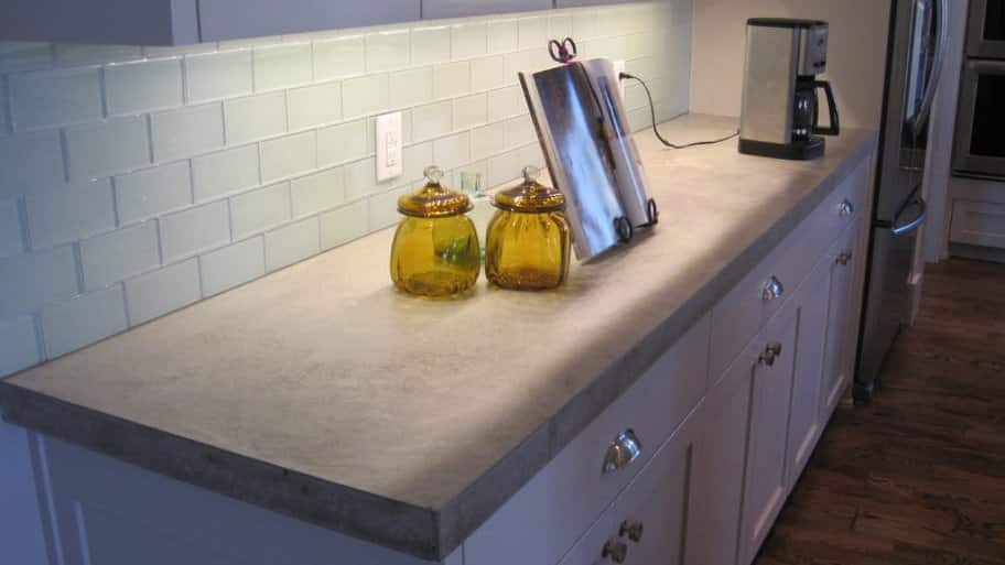 Task lighting under-cabinet lighting with a book and coffee maker on counter