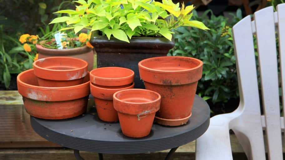 terracotta pots stacked on a patio table