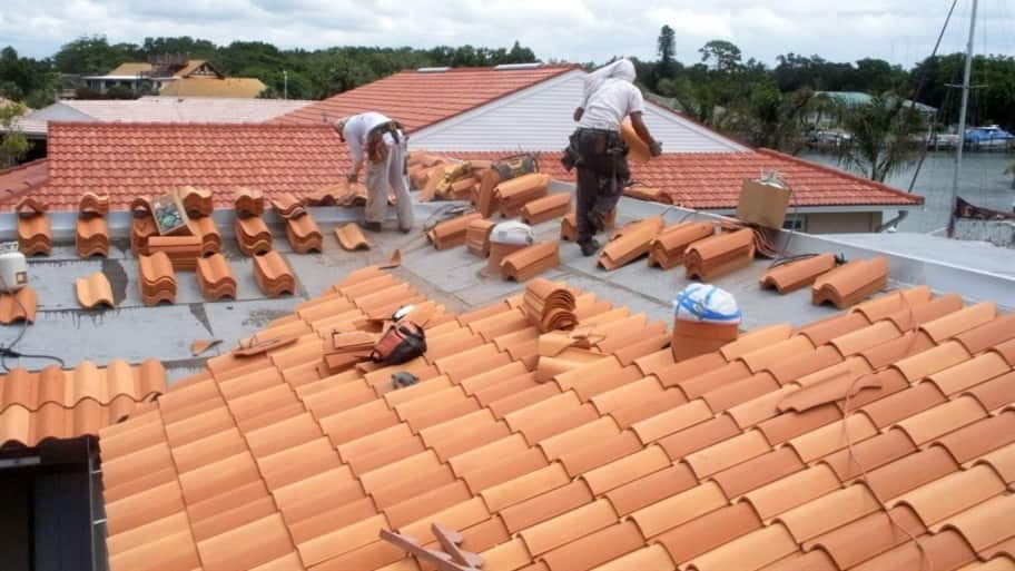 Perfect Roofers Installing Tile Shingle Roof On Florida Home