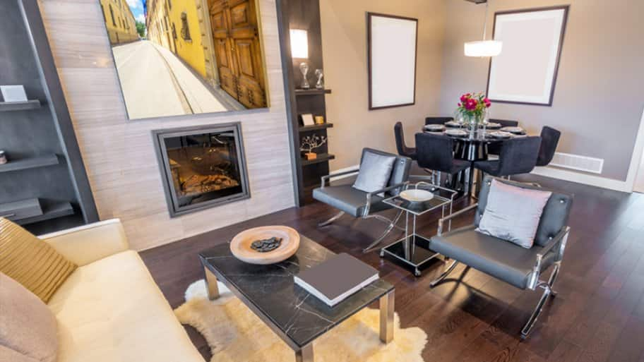 Modern living room with wood floors and artwork above fireplace