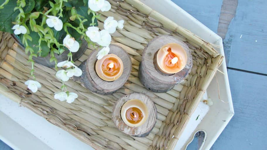DIY candle holders in a basket on table