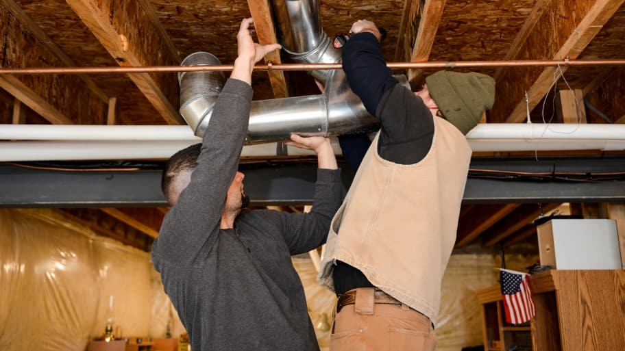 HVAC contractors work on ducts