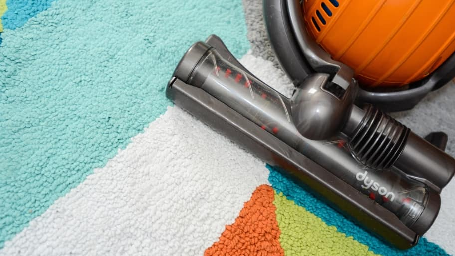 dyson vacuum cleaner on rug