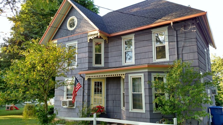 blue Victorian house exterior with cream and coral trim
