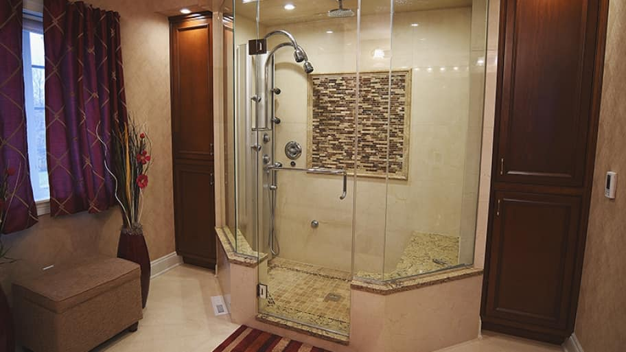 walk-in tile shower with glass door and enclosure