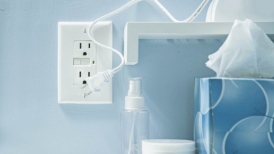outlet on blue wall