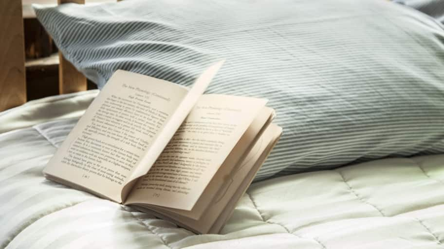 bed with open book