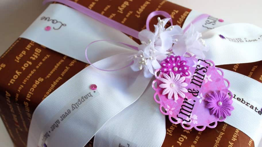 wedding gift wrapped with white bow