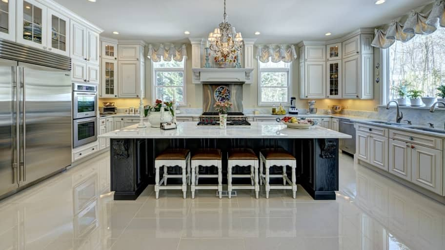 Kitchen With Large Island And White Countertops