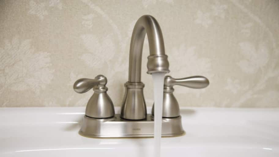 wonderful Reasons For Low Water Pressure In Kitchen Faucet #9: Faucet and flowing water. Sometimes low water pressure ...