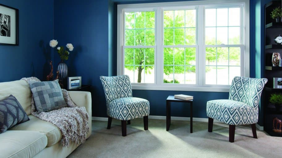 double-hung windows in blue living room