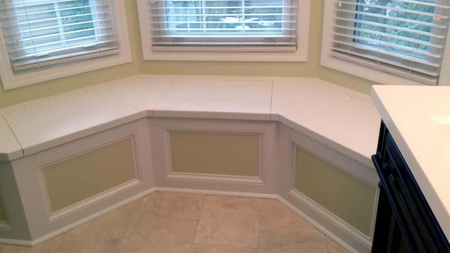 window seat under a bay window