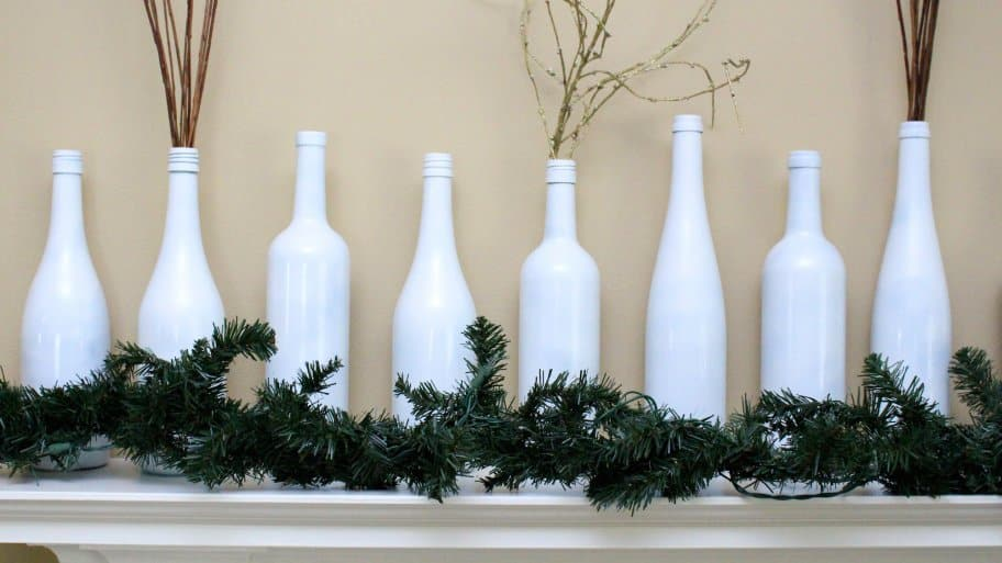 garland and wine bottle decorations on mantel