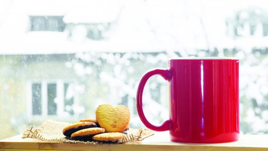winter window with coffee mug