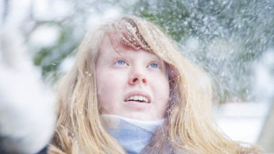A girl stands in the snow