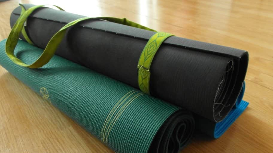 a stack of yoga mats