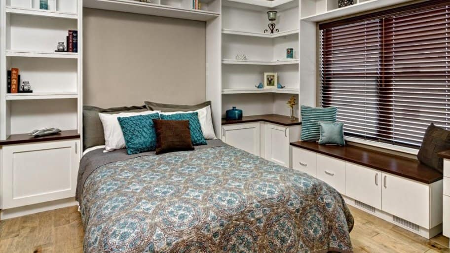 A Murphy bed with built-in shelving