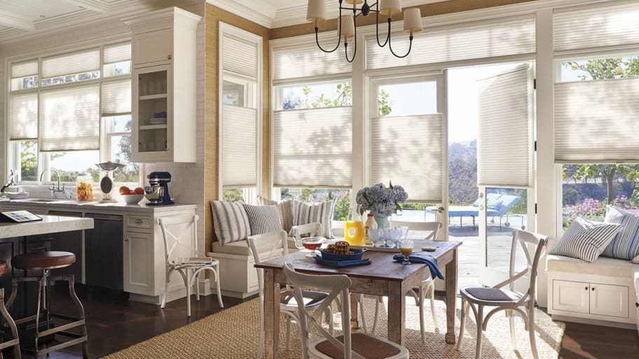An open kitchen with window treatments.