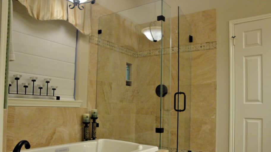 bathroom remodel with frameless glass shower door