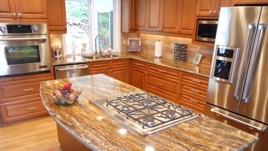 remodeled kitchen with stovetop island