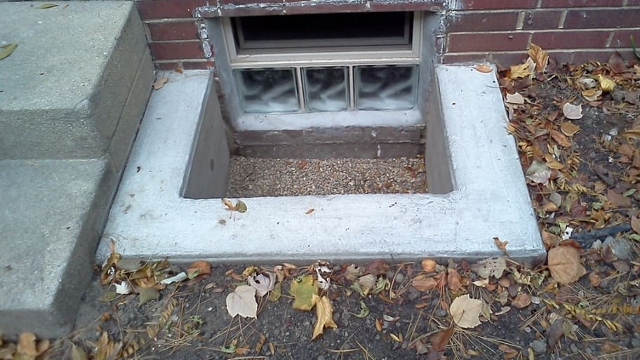 Small Basement Window And Concrete Window Well