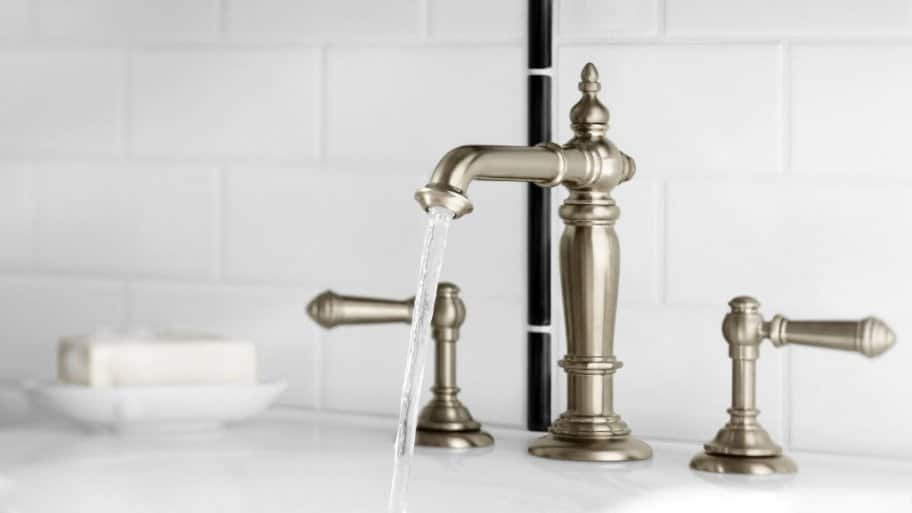 Water Pouring From Bathroom Faucet
