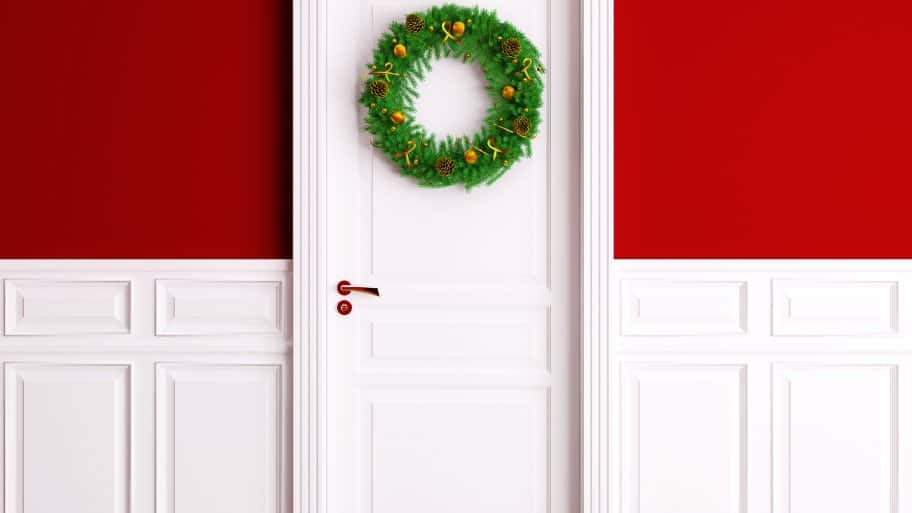 white front door with wreath