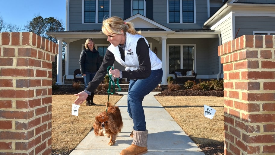 Is a hidden fence right for your dog angies list shannon potvin owner of atlanta dogwatch hidden fence trains a pet on its new boundaries as the dogs owner pam sullivan looks on photo by chris hunt solutioingenieria Image collections