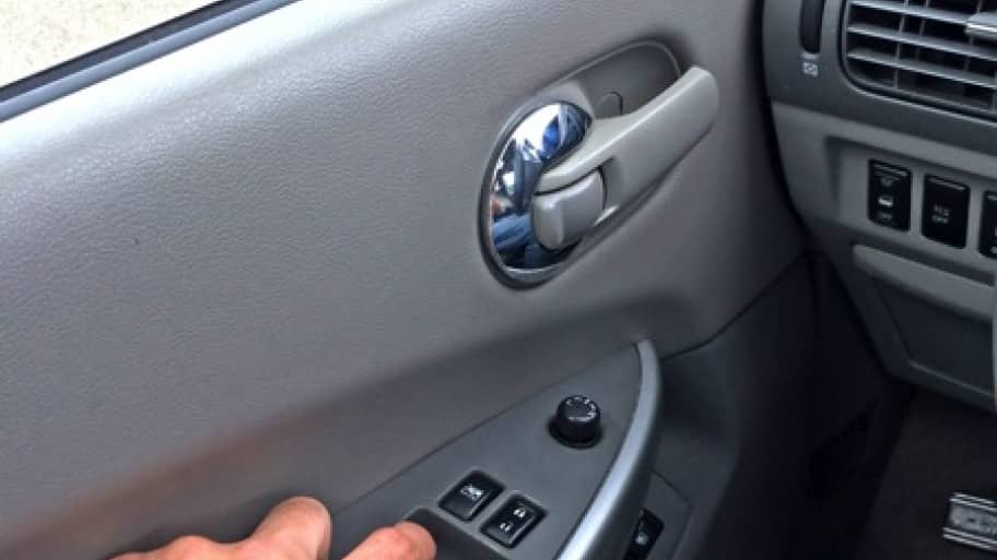 finger pressing car power windows button