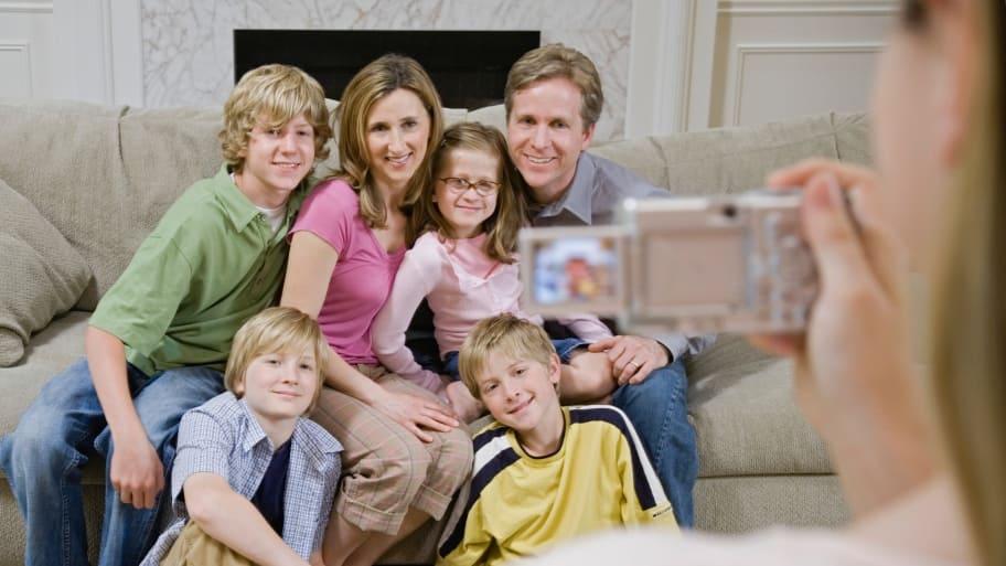 photographer taking photo of blended family