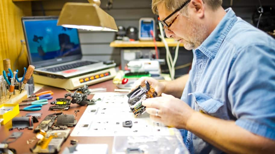 a man fixing an old camera