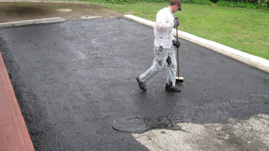 sealing an asphalt driveway is a messy job so wear disposable clothes. Black Bedroom Furniture Sets. Home Design Ideas