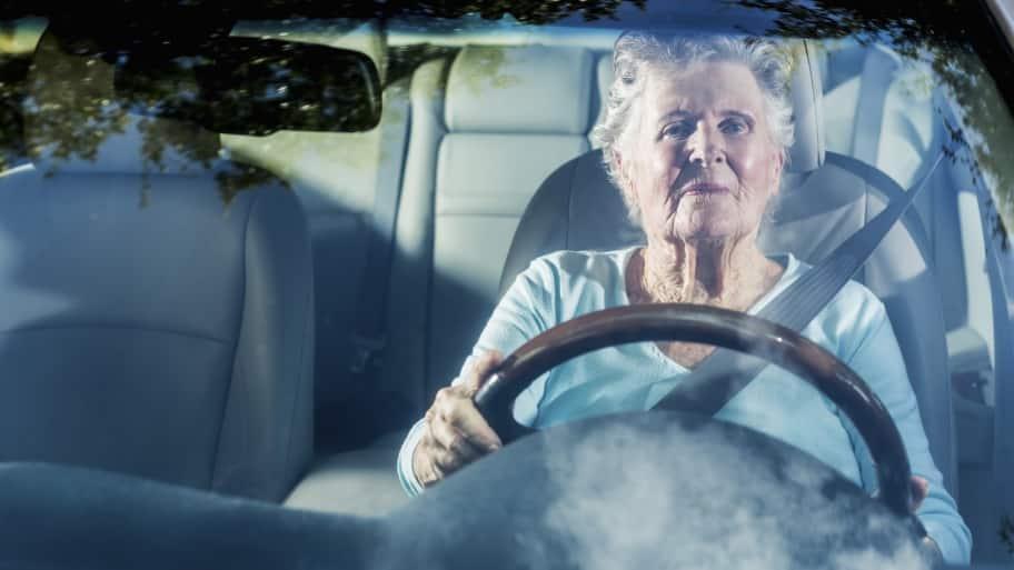 Elderly lady driving a car.