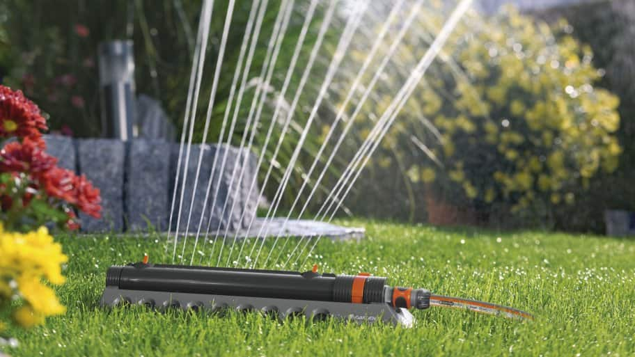 Water and fertilize your lawn throughout the summer for a beautiful landscape. (Photo courtesy of Gardena)