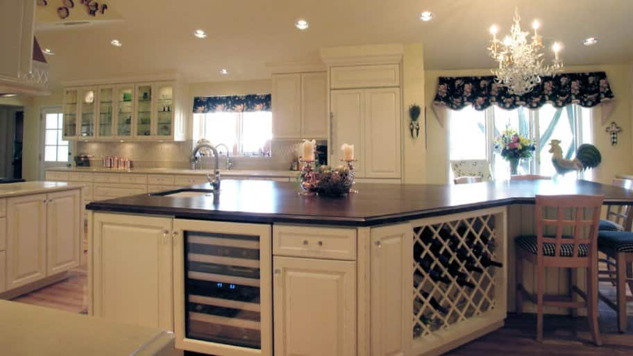 Large white kitchen island with wine rack