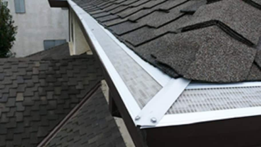 gutter guard protection system on a roof
