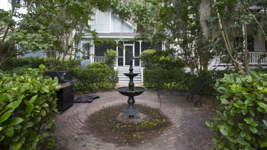 Backyard Brick Patio With Fountain In Savannah Georgia