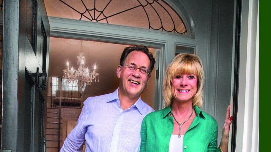 Tom Schmidt and Melissa Proffitt Schmidt at front door