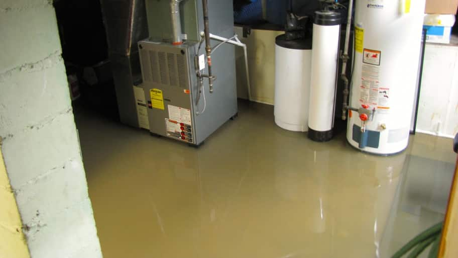 Prevent Basement Flooding With A Sump Pump. Standing Water In Basement