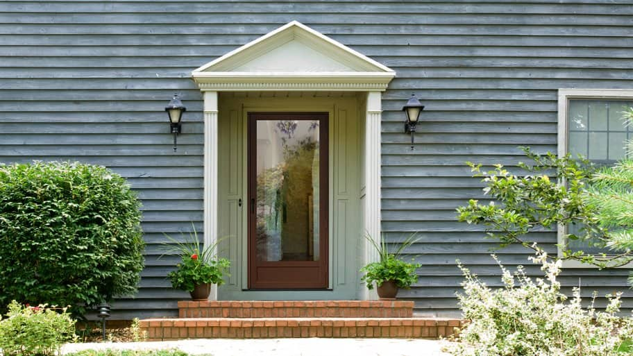 Exterior shot of a home with blue siding and a ProVia brand storm door. & Are Storm Doors Really Necessary? | Angie\u0027s List