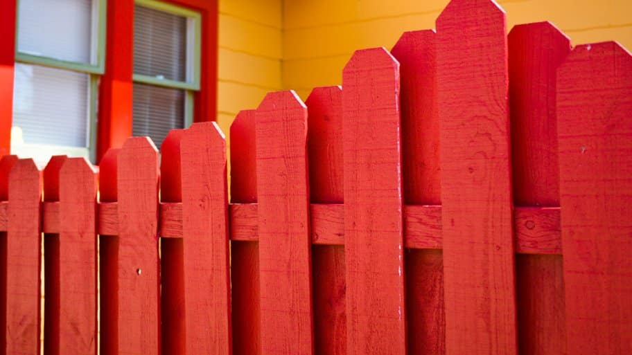 red painted wood fence