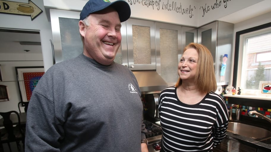 man and woman laughing in kitchen