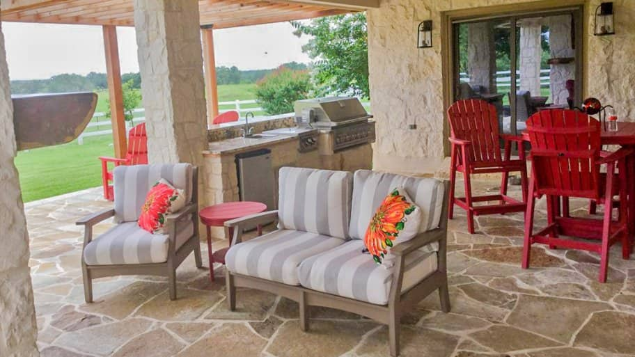 flagstone patio, outdoor kitchen, grill, patio furniture