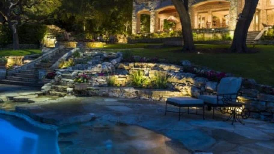 Regular maintenance of an outdoor lighting system is crucial, including using waterproof connectors that can withstand the elements. (Photo by NightScenes Landscape Lighting Professionals)