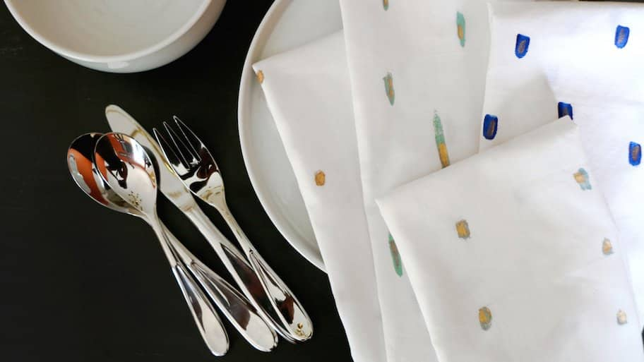 painted cloth napkins at place setting on table
