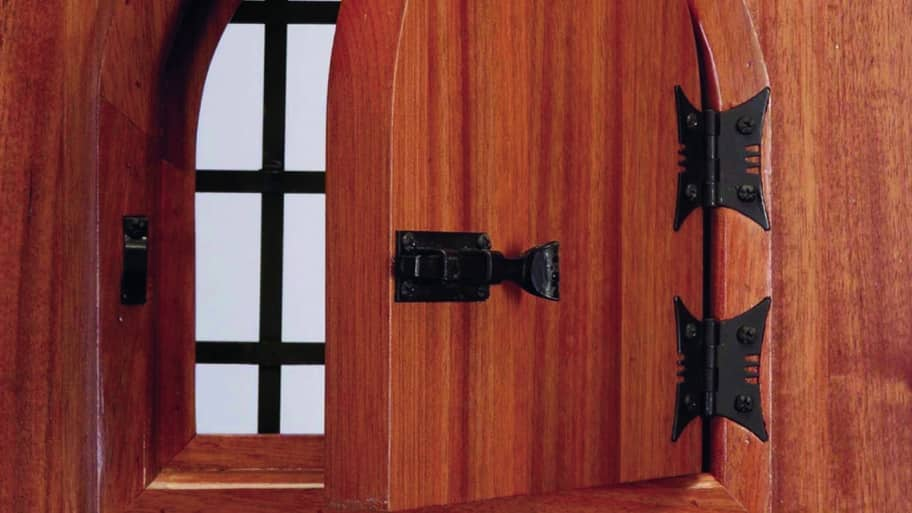 Pella speakeasy wood front door with cutout peephole