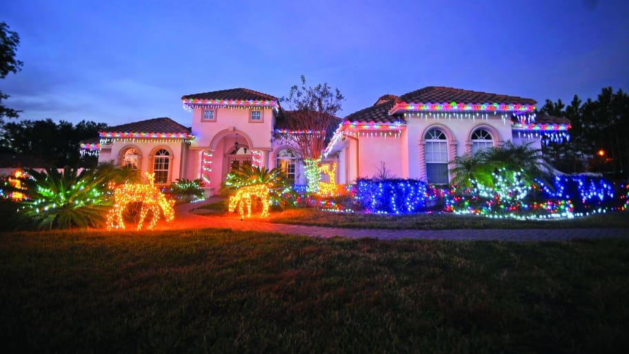 Two-story home with elaborate Christmas lights