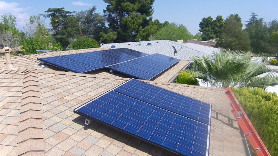 Solar Panels On The Shingled Roof Of A Home In Southern California.