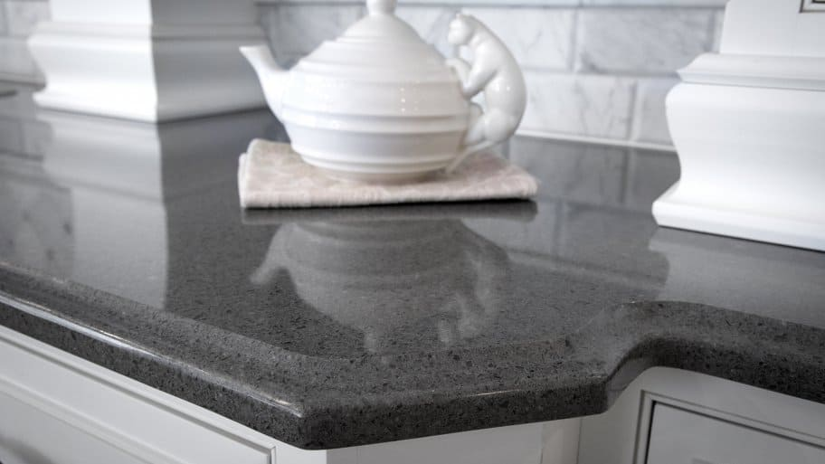 black quartz countertop with teapot on towel